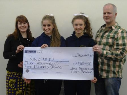 Ellen Robinson & Hannah Wilkinson of 297th Girls Brigade present cheque for £2500 to Jonathan and Keira Dobbin of Kindfund
