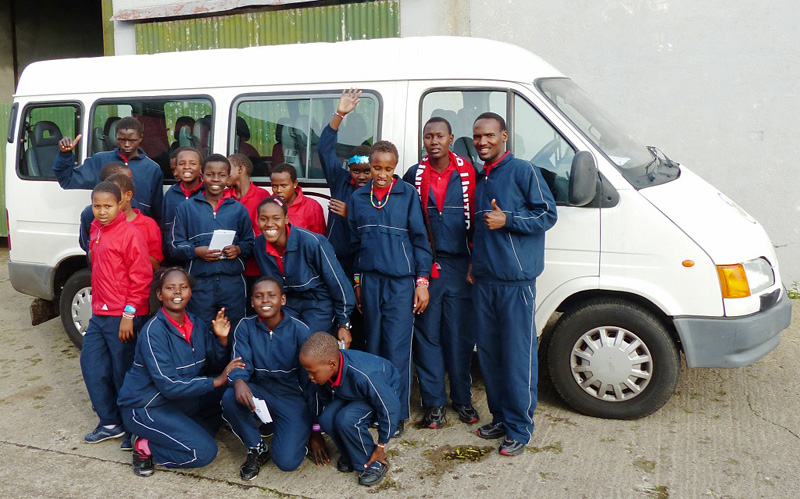 kindfund children and staff with their minibus
