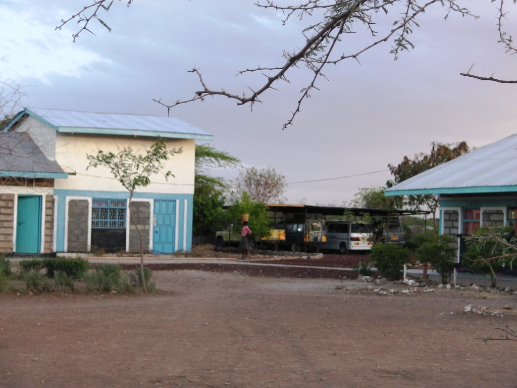 first two-storey, paths and vehicles at ngaremara