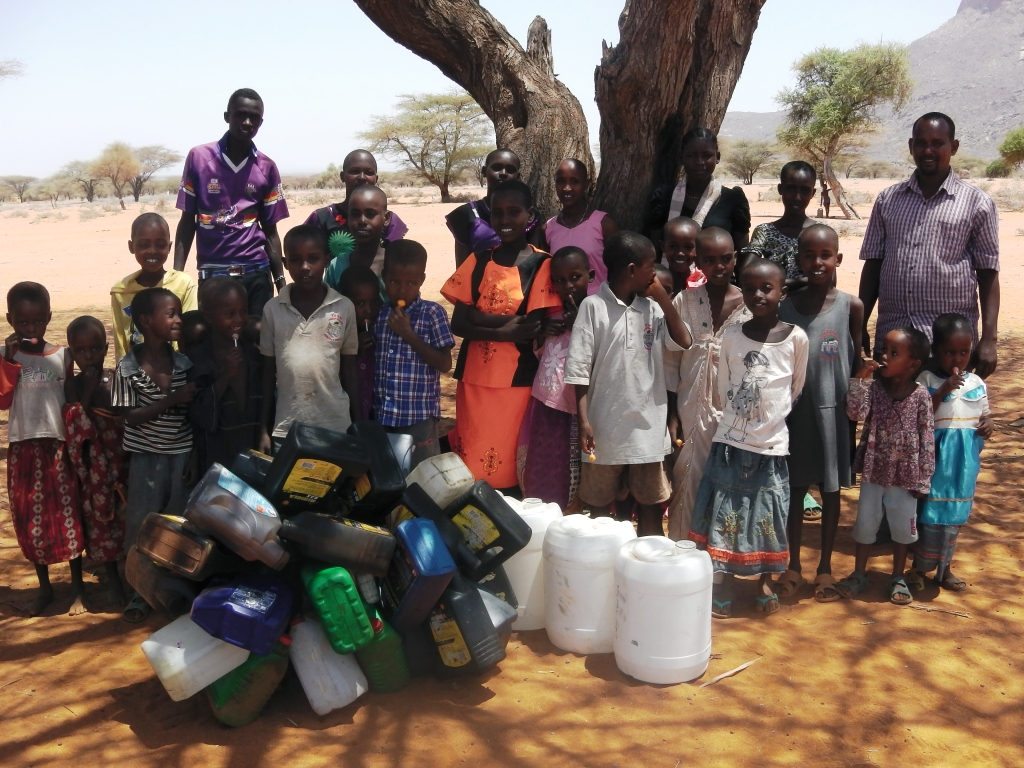 Ngaremara girls present water carriers to Kindfund Rendille project