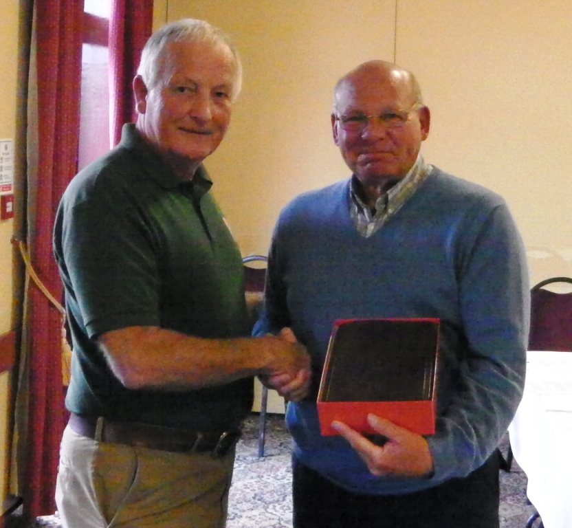 Ken presents to Phil on retirement as chairman