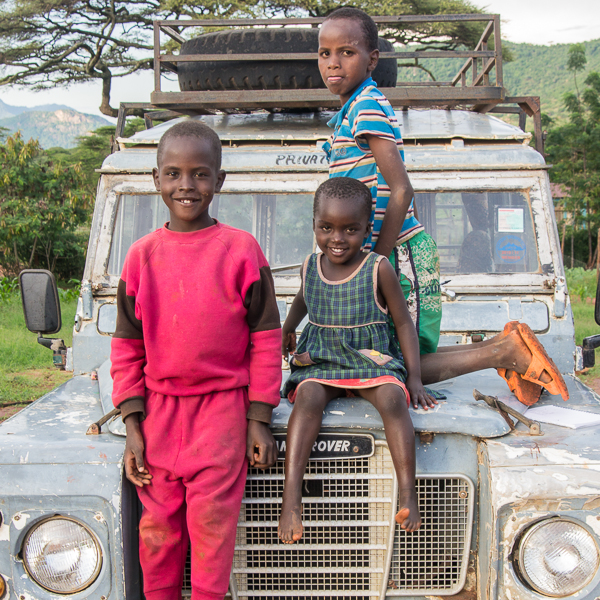 wamba - children sitting on the bonnet of our battered land rover