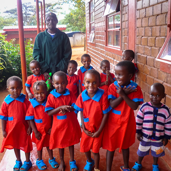 children in red school uniform - wamba, kenya
