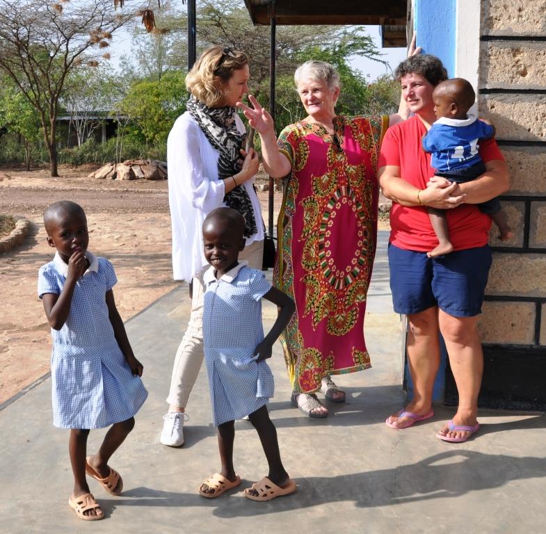 Evelina, Pamela and Gillian with children