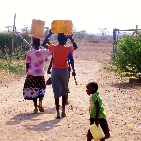 children walking to fetch water